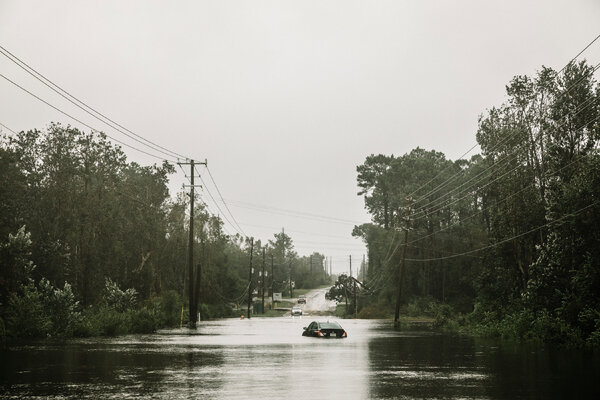 Water gushed like a river through the streets of Pensacola.