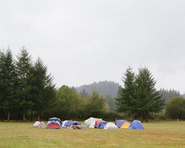 A pod of tents at Amboy Territorial Park in Amboy, Wash., for firefighters battling theBig Hollow Fire. Visitors must be approved and get their temperatures checked.  Covid-19 Adds Complications to Portland-Area Firefighting Efforts merlin 177239313 23191e4f 6179 4fcb adc0 e61fcf1b675e articleLarge