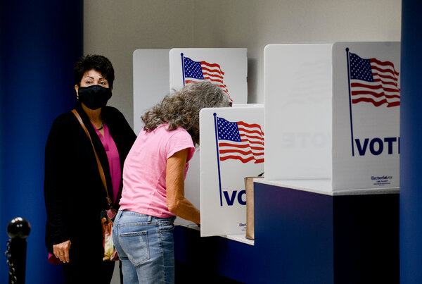 In-person early voting began on Thursday in Michigan, one of the states President Trump won in 2016 that Democrats hope to reclaim.
