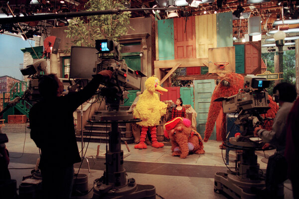 """Food Big Bird and friends on the set of """"Sesame Street"""" in 1995."""