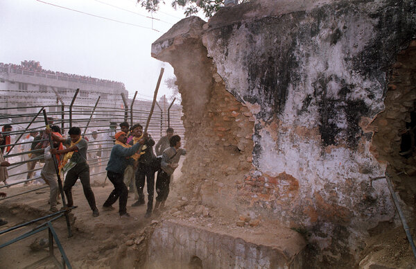 Extremists attacking the walls of the Babri Mosque with iron rods in Ayodhya, India, in 1992.