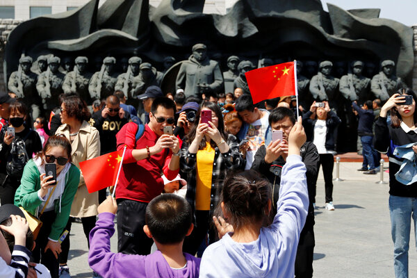 Chinese tourists last year in the city of Dandong, near statues of soldiers who took part in the Korean War.