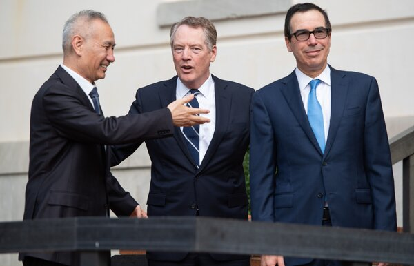 Mr. Lighthizer, center, was the primary negotiator in trade talks with China, which were led by Vice Premier Liu He.