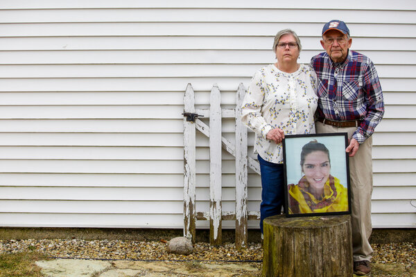 Julie and Bill Heiderman with a portrait of their daughter, Bernice, who died in 2018.