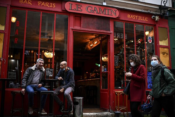 Patrons enjoying a drink on the terrace of a bar in Paris on Saturday.