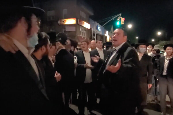 "Heshy Tischler, center right, addressed the crowd in Borough Park late Tuesday, saying: ""You are my soldiers! We are at war!"""
