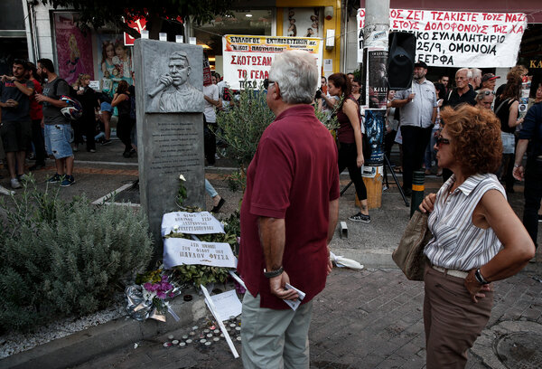 A memorial at the site where the rapper Pavlos Fyssas was stabbed in 2013. A Golden Dawn member was found guilty of the murder on Wednesday.