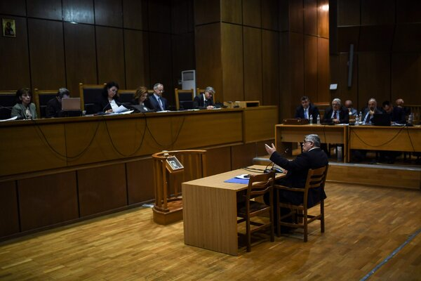 Golden Dawn's leader, Nikos Michaloliakos, testifying in an Athens court in November.