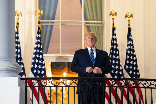 President Trump on the Truman Balcony of the White House on Monday after being discharged from Walter Reed National Military Medical Center.