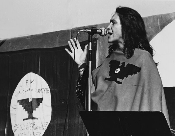 Dolores Huerta on stage at a United Farm Workers rally in California, circa 1975 or 1976.