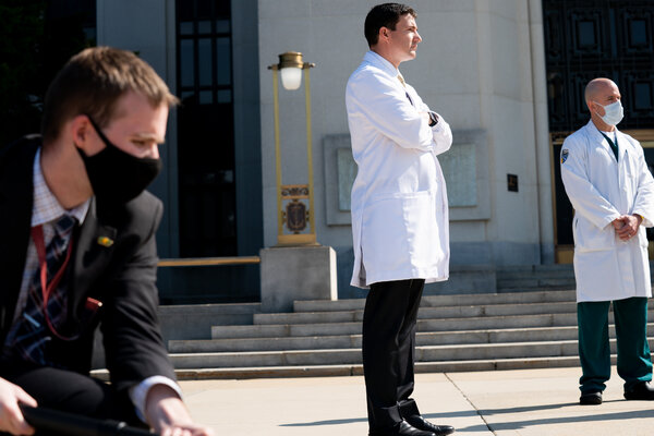 Dr. Sean P. Conley, center, the White House physician. Experts have repeatedly called into question the true severity of President Trump's illness.