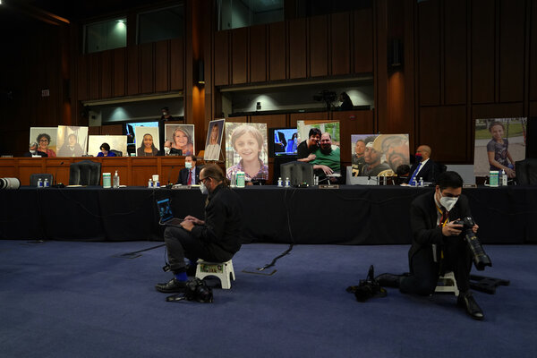 Pictures of people who would be negatively affected if the Affordable Care Act were repealed, displayed in the hearing room on Monday.