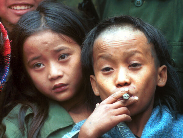 Johnny, left, and Luther Htoo in 1999. At the time, the boys took command of an army of rebel soldiers who believed the twins possessed magical powers.