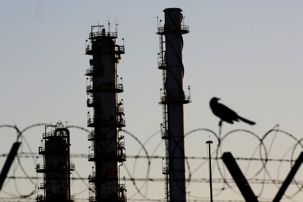 A refinery near Monterrey, Mexico. The International Energy Agency forecast significant declines in oil demand and carbon-dioxide emissions this year.