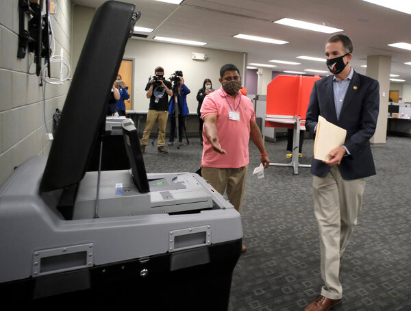 Gov. Ralph Northam of Virginia, right, said Tuesday that he would back a court order extending the state's registration deadline.