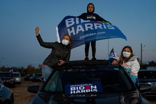 A drive-in crowd listened to Democratic presidential candidate Joe Biden at the Michigan State Fairgrounds in Detroit on Friday.