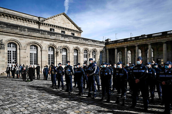Police officers in Bordeaux, France, observed a moment of silence on Monday for Samuel Paty.