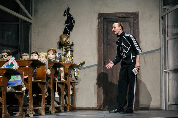 """Weigel in a schoolroom scene from """"A Youth in Germany."""" The puppets were created byMichael Pietsch."""