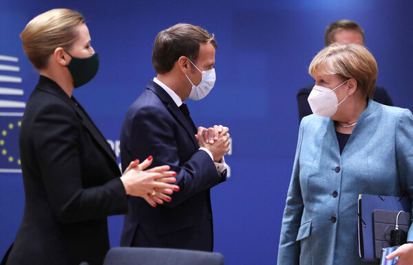 From right, Germany's chancellor, Angela Merkel, with President Emmanuel Macron of France and Prime Minister Mette Frederiksen of Denmark in Brussels last week.