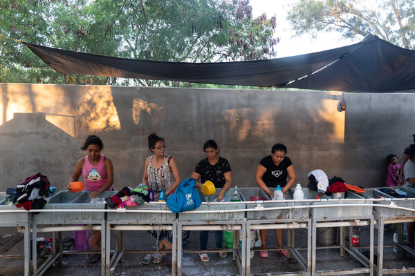 Women washing clothing inside the camp.