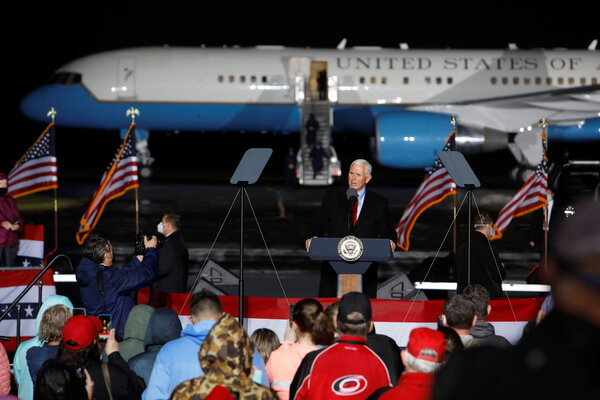 Vice President Mike Pence spoke at a rally in Kinston, N.C., on Sunday but did not mention the coronavirus cases that had infiltrated his staff.