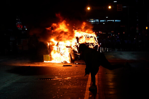 A police car burned during a protest late Monday in Philadelphia after Walter Wallace Jr. was shot by the police.