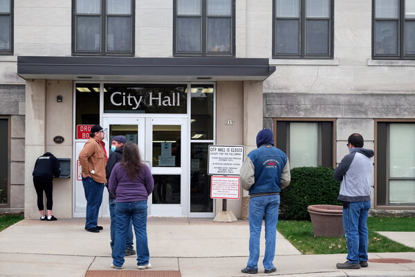Waiting to cast in-person absentee ballots in the presidential election this month in Oshkosh, Wis.