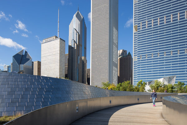 The BP Pedestrian Bridge, designed by Frank Gehry, links Maggie Daley Park to Millennium Park in Chicago.