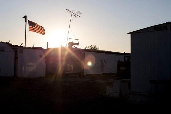 An American flag waves in early morning light in Yuma.