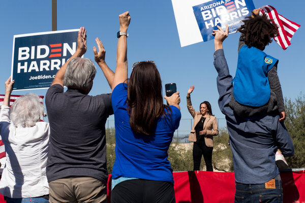 Senator Kamala Harris concludes her speech during a drive-in rally at Pima Community College's West campus in Tucson.