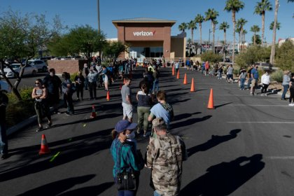 Voters lined up at a polling location in Las Vegas on Friday. Twelve states, including Nevada, have surpassed 80 percent of the turnout from the last presidential election.