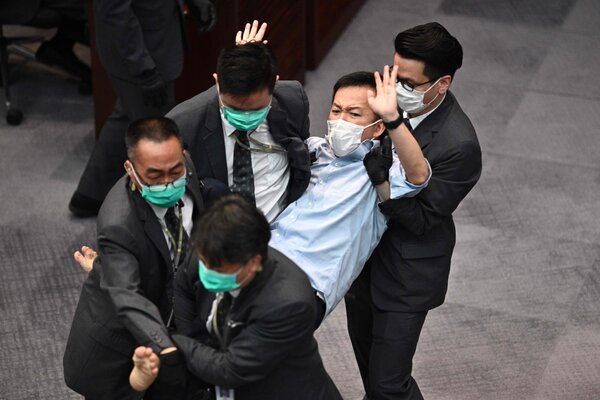 At the council meeting in May, the pro-democracy lawmaker Raymond Chan was carried away by security officers after scuffles with pro-Beijing legislators.