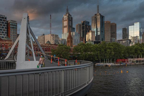 A lone woman walking across the usually busy Evan Walker Bridge in Melbourne, Australia, last month.