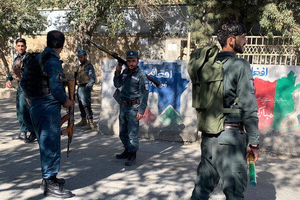 Afghan police officers arriving at the university.Video and photographs posted to social media showed students scrambling for cover and clambering over walls to get to safety during the attack.
