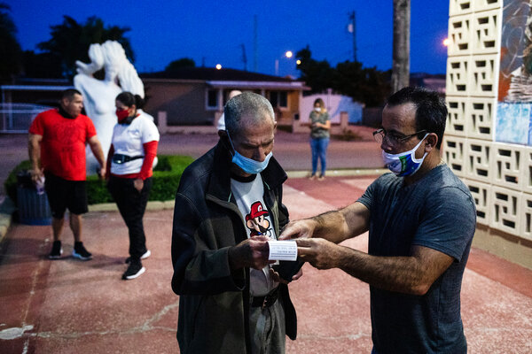 An elections worker helped a voter find his polling station in Hialeah, Fla., early Tuesday.