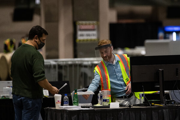 Election workers in the ballot counting area at the Pennsylvania Convention Center on Friday.