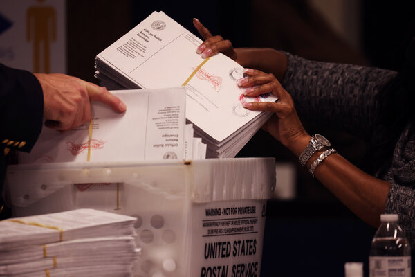 The Mecklenburg County Board of Elections met in Charlotte, N.C., on Friday to count provisional and absentee ballots.