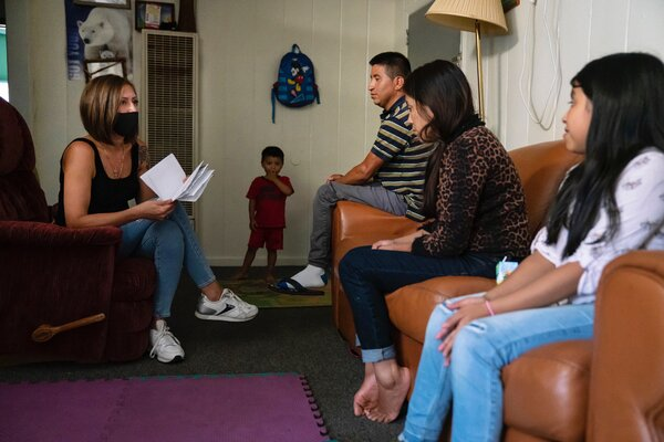 The Doraville City Council member Rebekah Cohen Morris, left, meeting with a family in her district.