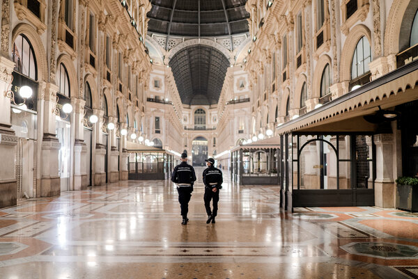 Police patrolling during the first day of a lockdown in Milan on Friday. Italy and France reported record numbers of coronavirus infections in recent days.