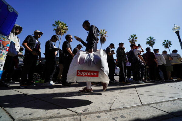 Shoppers outside the Supreme clothing store in Los Angeles in 2019. The company is known for getting fans to line up, and even camp out, outside its stores.