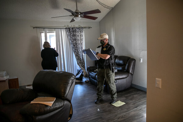 A county constable delivered an eviction order in Phoenix in September. The expiration of emergency federal programs could leave millions vulnerable to eviction.