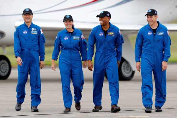 Astronauts Soichi Noguchi, left, Shannon Walker, Victor Glover and Mike Hopkins at Cape Canaveral before the launch.