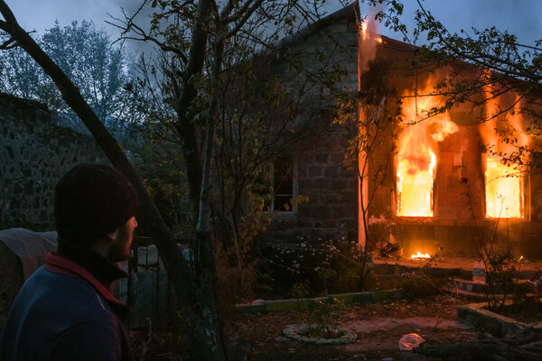 As they prepared to leave, many residents set fire to their homes in the Kelbajar district.