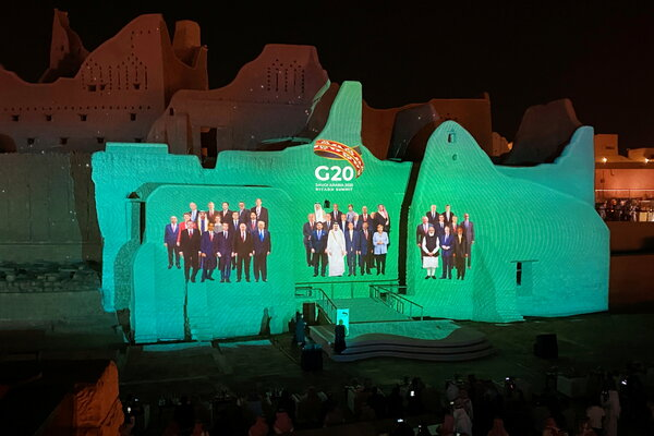"A digital ""family photo"" of G20 leaders projected at the Salwa Palace in Diriyah, Saudi Arabia."