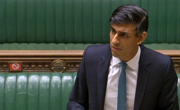 "Rishi Sunak, Britain's chancellor of the Exchequer, addressing Parliament on Wednesday. ""Our economic emergency has only just begun,"" he said."