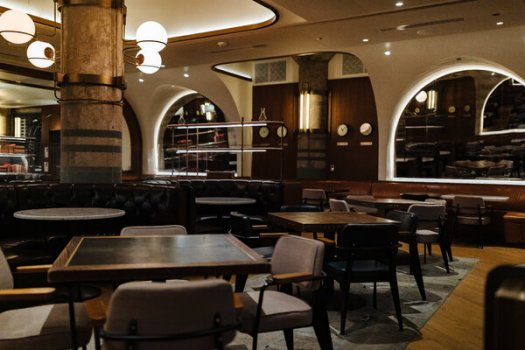 """The dining room at Swift & Sons is empty. The Chicago restaurant is part of a group co-founded by Kevin Boehm, who said that without help, """"we can't make it to April or May."""""""