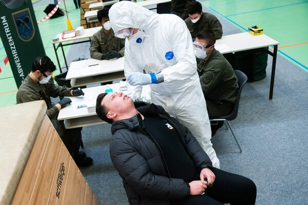 A doctor performing a Covid-19 test in Korneuberg, Austria on Friday. The Austrian military will help test as many as 150,000 residents per day under the country's new mass testing program.
