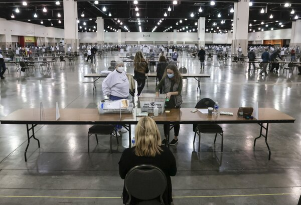 Election officials counting votes during a recount in Milwaukee this month.