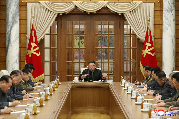 Kim Jong-un met with government officials on Sunday, seen in this photo provided by the North Korean government.