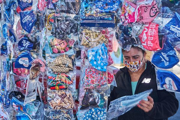A mask vendor in the Echo Park section of Los Angeles on Thursday.
